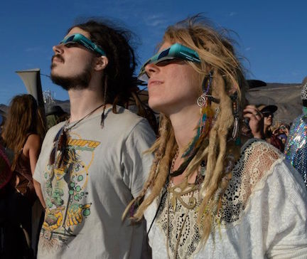 Papadosio's Anthony Thogmartin and Georgia Beasely scope the eclipse  at Pyramid Lake in 2012
